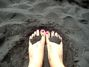 Pink toes on black sand